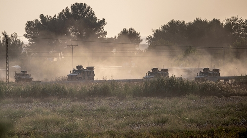 Turkish army vehicles drive towards the Syrian border near Akcakale in Sanliurfa province on October 9, 2019. - Turkey launched an assault on Kurdish forces in northern Syria on October 9 with air str