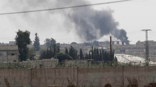 Smoke rises in the Syrian border town of Tel Abyad, as seen from Akcakale