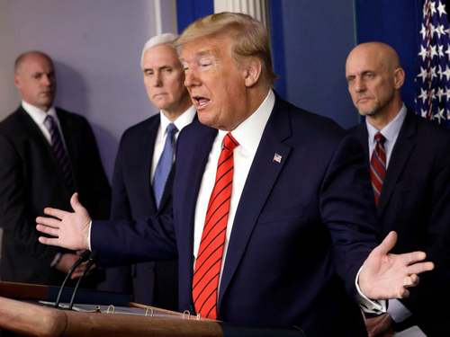 Trumps coronavirus claims are undercut by FDA official as former aide appears to pledge allegiance to QAnon