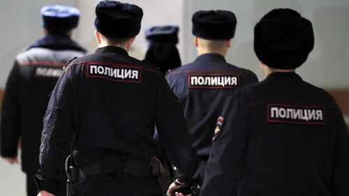 Russian Police Raid Khodorkovsky-Backed Media, Opposition Group
